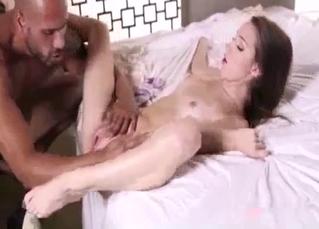 Slutty babe fucks daddy with her legs spread
