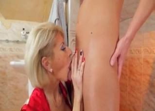 Mommy in red loves sucking dicks