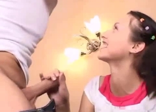 Pigtailed brunette jerks her brother