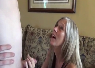 Obedient mommy blows her son