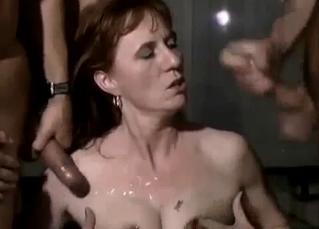Dark-haired slut covered in son's cum