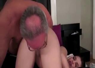 Ponytailed babe fucking her daddy