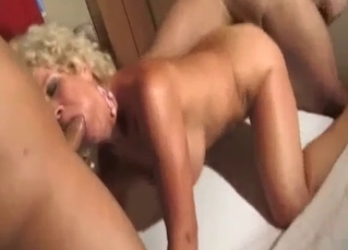 Tanned MILF fucking her two sons