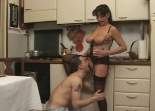 Big-breasted mommy about to fuck him