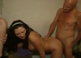 Raven-haired lass sucking mature cock